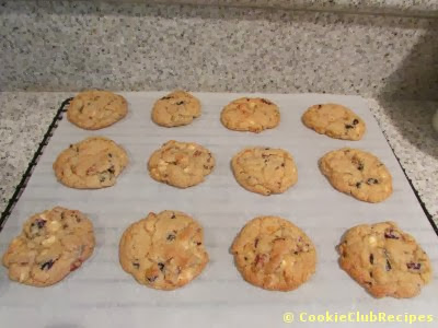 dozen cookies cooling on rack