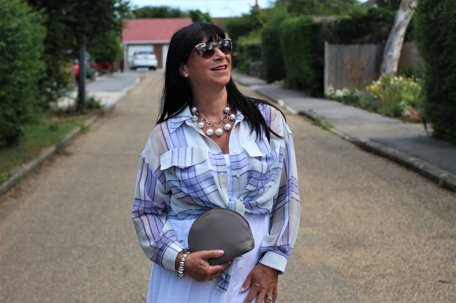 Over 50s blogger Jacqui Berry from Mummabstylish in the Check Me Out challenge, wearing a check blouse over a dress