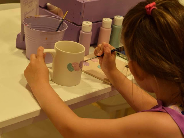 Painting a mug at Emily's Paint a Pot in Next, Manchester Arndale