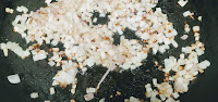 Sauteing chopped onion in pan for paneer butter masala recipe