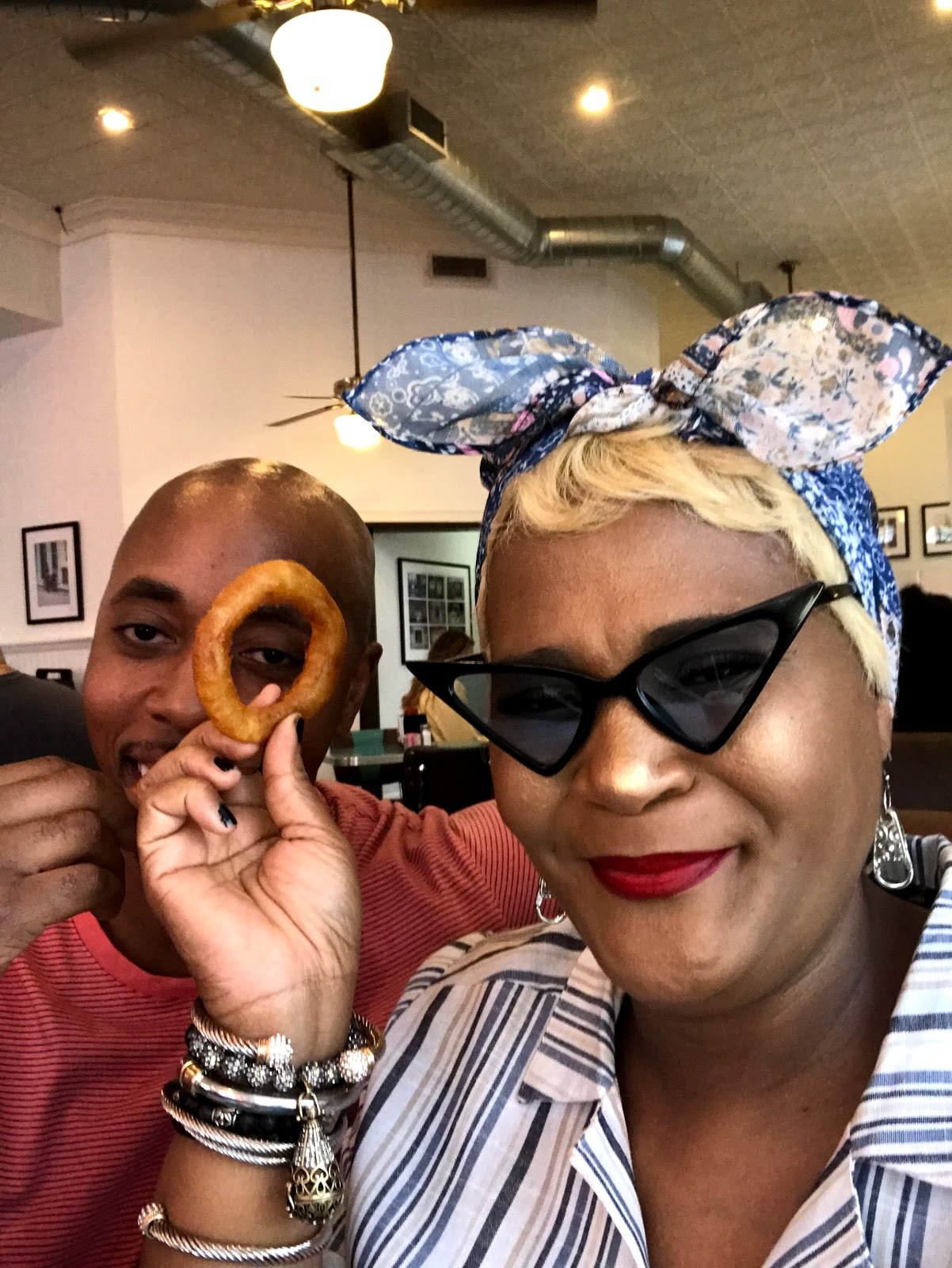 Image: Tangie and her Husband eating onion rings at Honky's burger bar in Bishop Arts District