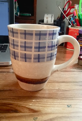 a giant coffee cup