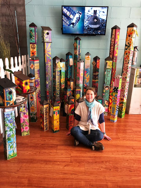 Here I am sitting with the Garden Art Poles at The Wildbird Shack.