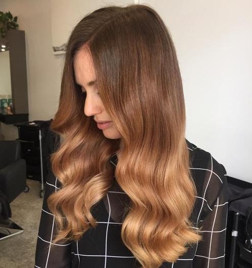 ¿Listo para conseguir atrevido con el color de pelo más brillante y más inusual para el invierno? Esta naranja de fuego le dará una razón para sonreír cada
