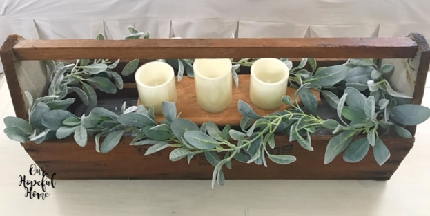 vintage wooden tool box LED candles eucalyptus garland