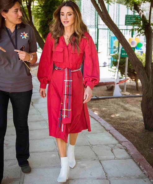 Queen Rania of Jordan visited Masahati Carnival organized by Madrasati initiative at Millennium Park in Amman. Queen wore red vintage shirt dress