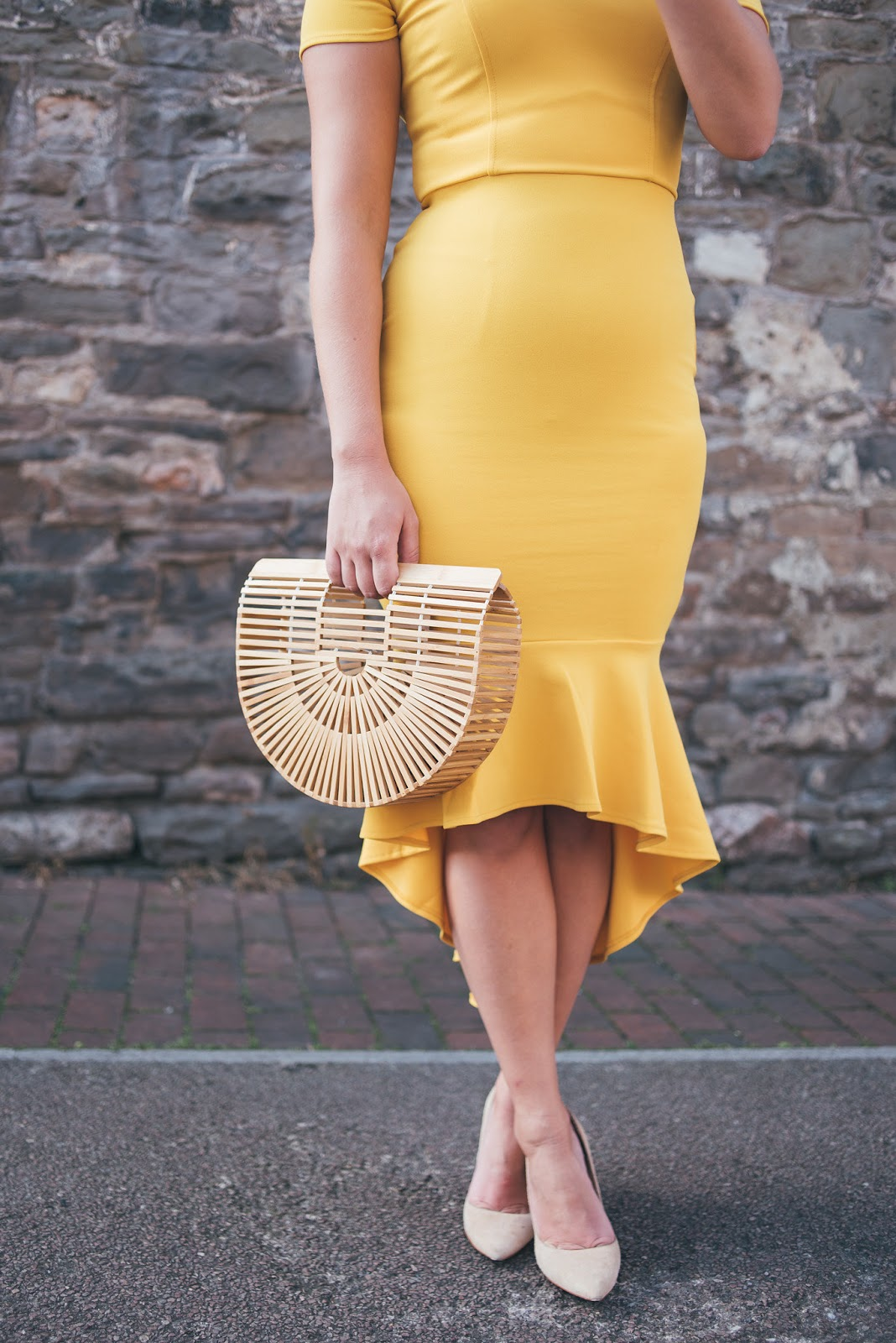Fishtail of the Yellow John Zack Dress with Cult Gaia Dupe Bag