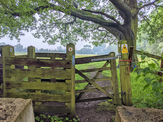 The guard dog warning sign at the gate at the northern end of the footpath
