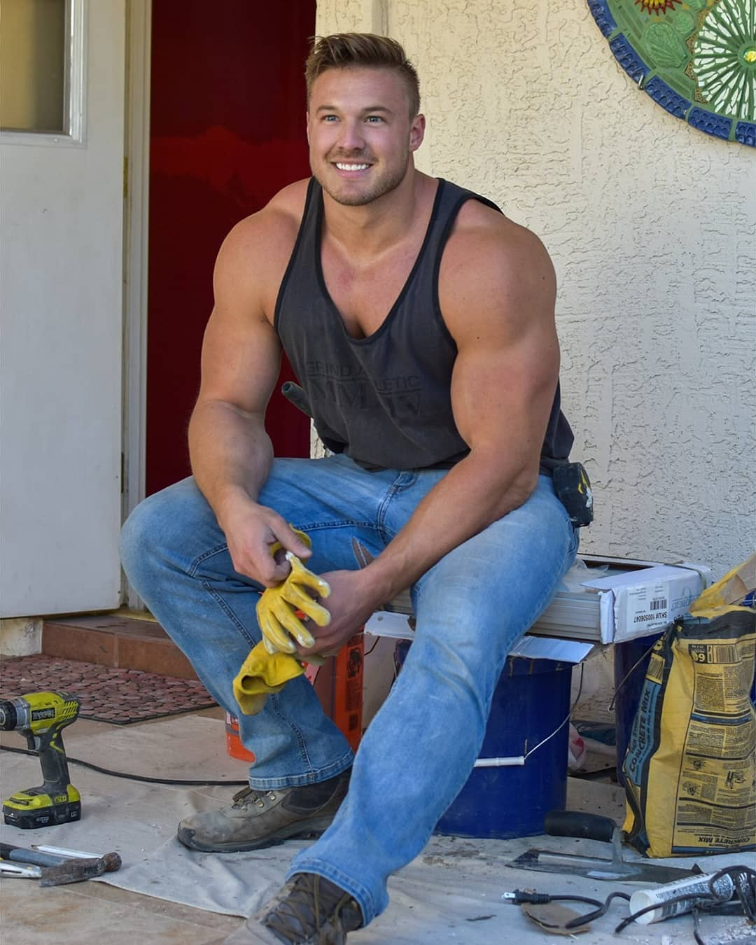 huge-blond-muscle-beefcake-male-hunk-hard-worker-smiling-jeans