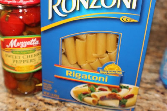 this is a photo of rigatoni pasta in a box and bottle of cherry peppers to make Chicken Riggies