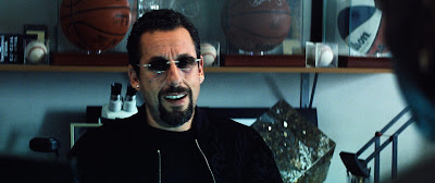 """In """"Uncut Gems,"""" Adam Sandler plays Howard Ratner, an unscrupulous but charismatic New York jeweler who bites off more than he can chew."""