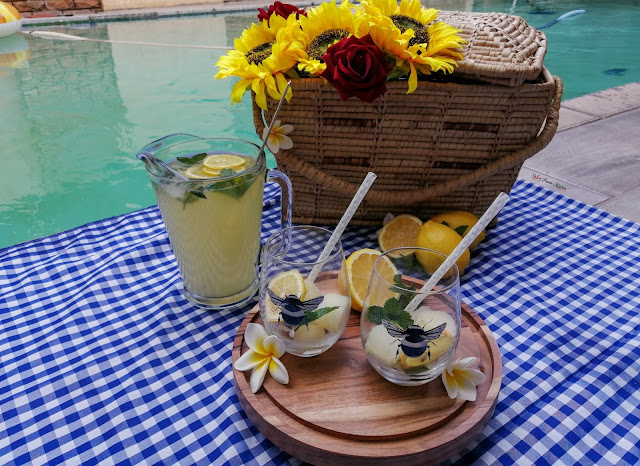 Home-made Lemonade, home-made, lemonade, lemonade recipe, picnic, pool side, drinks, summer, summer drinks, drinks recipe, food photography, drinks photography, weekend vibes, food blog, food blogger, spicy fusion kitchen, mr price home, bee, bees tumbler, kenwood, pinterest, sunflowers, flowers, lemons, mint,  roses, botswana