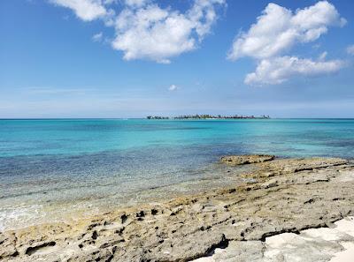 calm sea with rocky dhore