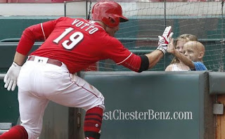Joey Votto giving high-five to little-fan