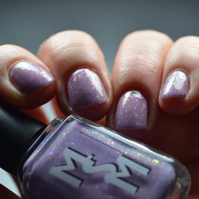 lilac nail polish with aurora shimmer and flakies swatch