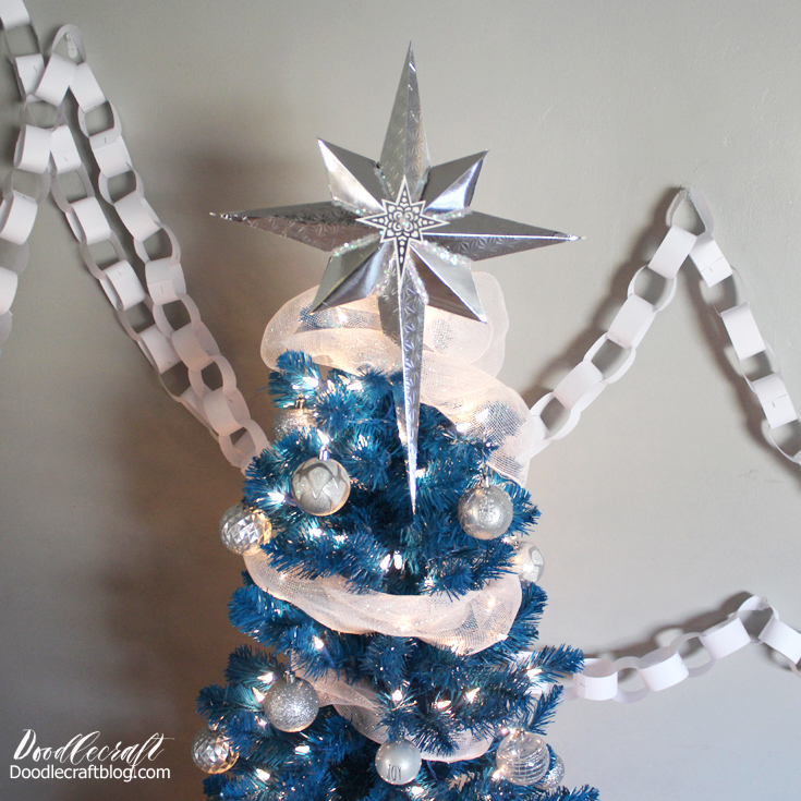 Silver Bells and Blue Christmas mash-up tree--bright blue tree with clear lights adorned with silver and white sparkly decorations