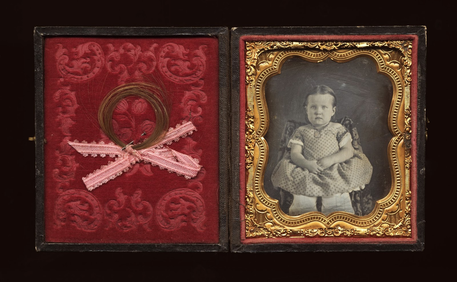 Cased image of girl with a lock of hair pinned to interior (Montana Historical