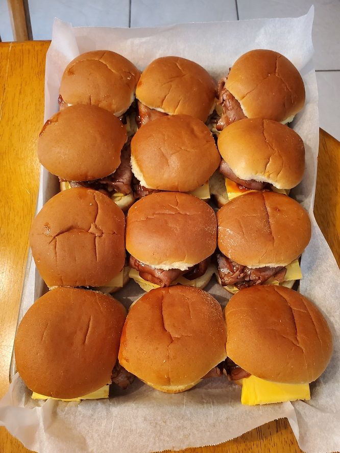 these are 12 slider buns filled with roast deli beef and sharp cheddar cheese with barbecue sauce