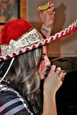 Woman Drinking Shot Of Tequila.