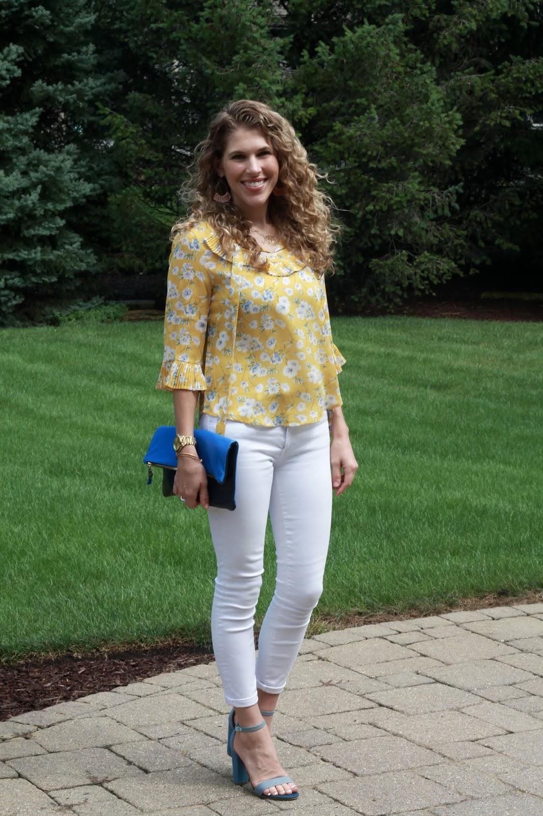 yellow floral tie neck blouse, white denim, denim heels, blue clare v. clutch