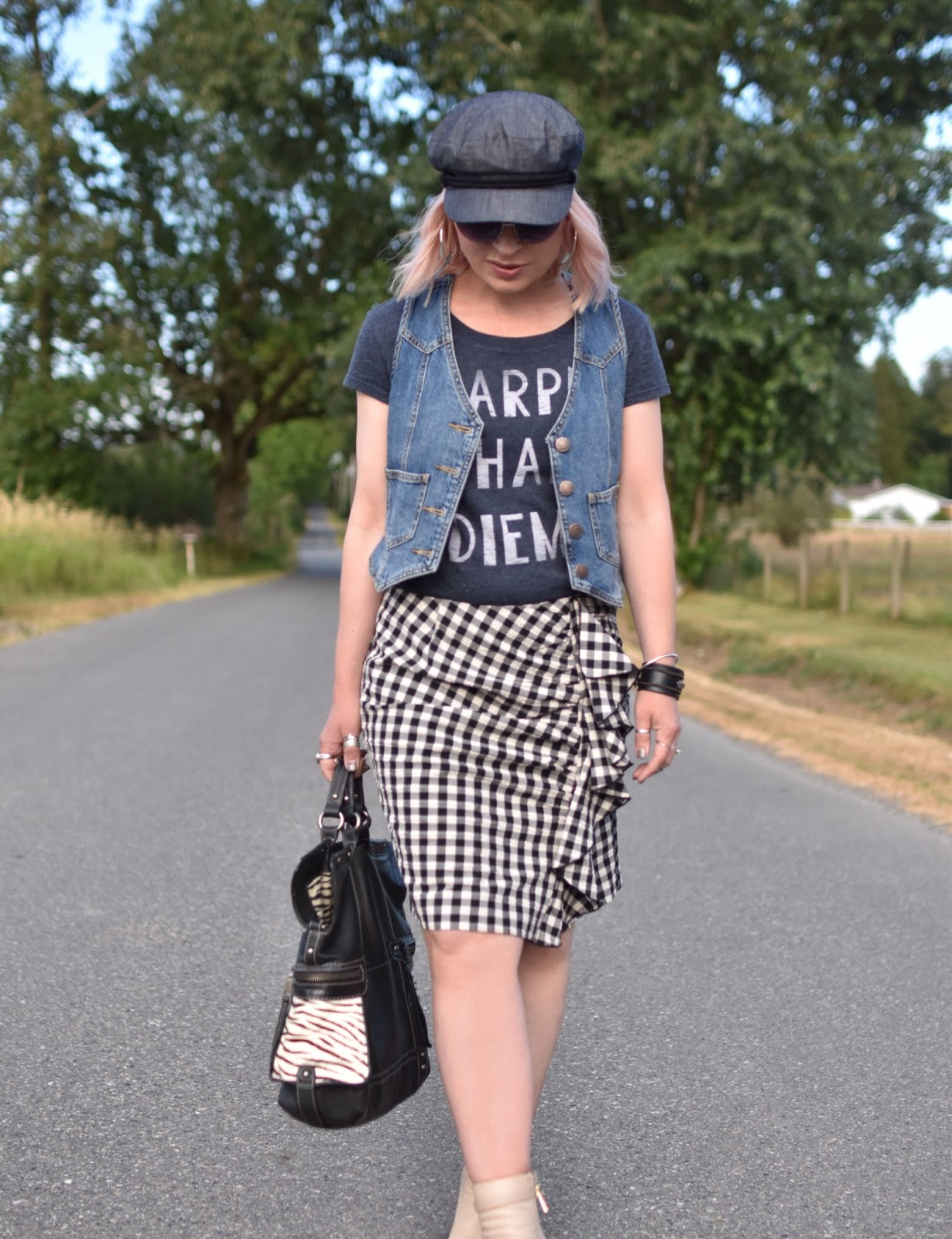 Monika Faulkner personal style inspiration - ruffled gingham skirt, graphic tee, denim vest, baker boy cap, sunglasses, Fossil bag