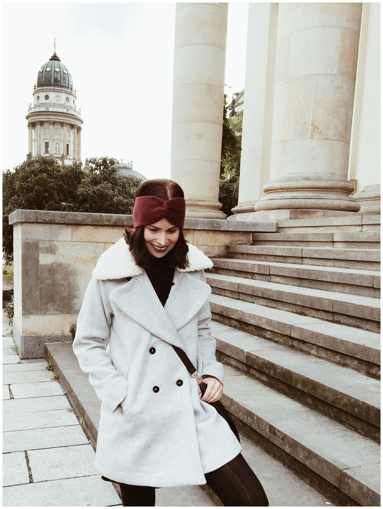 BERLIN – FRENCH CATHEDRAL | June Gold wearing light grey Mango coat with fake fur