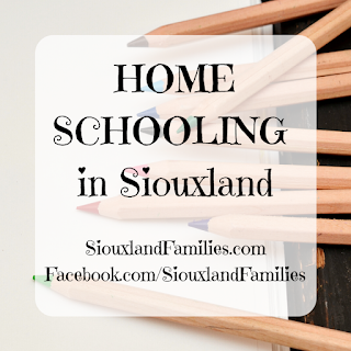 """In background, wooden colored pencils sit on natural colored paper. in foreground, """"homeschooling in Siouxland"""" and """"SiouxlandFamilies.com Facebook.com/SiouxlandFamilies"""""""
