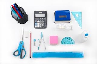 desk with school supplies, in between classes