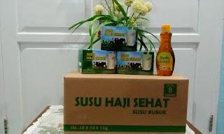 """Promo """" Setiap Pembelian 1 karton Susu Haji Sehat akan mendapatkan Bonus Tambahan 1 Botol Madu Murni (Ukuran 400 ml)"""