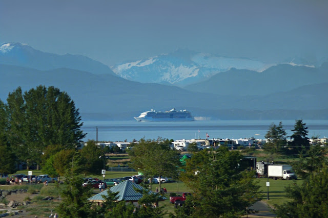 A cruise ship makes its way up the Inner Passage of Vancouver Island...