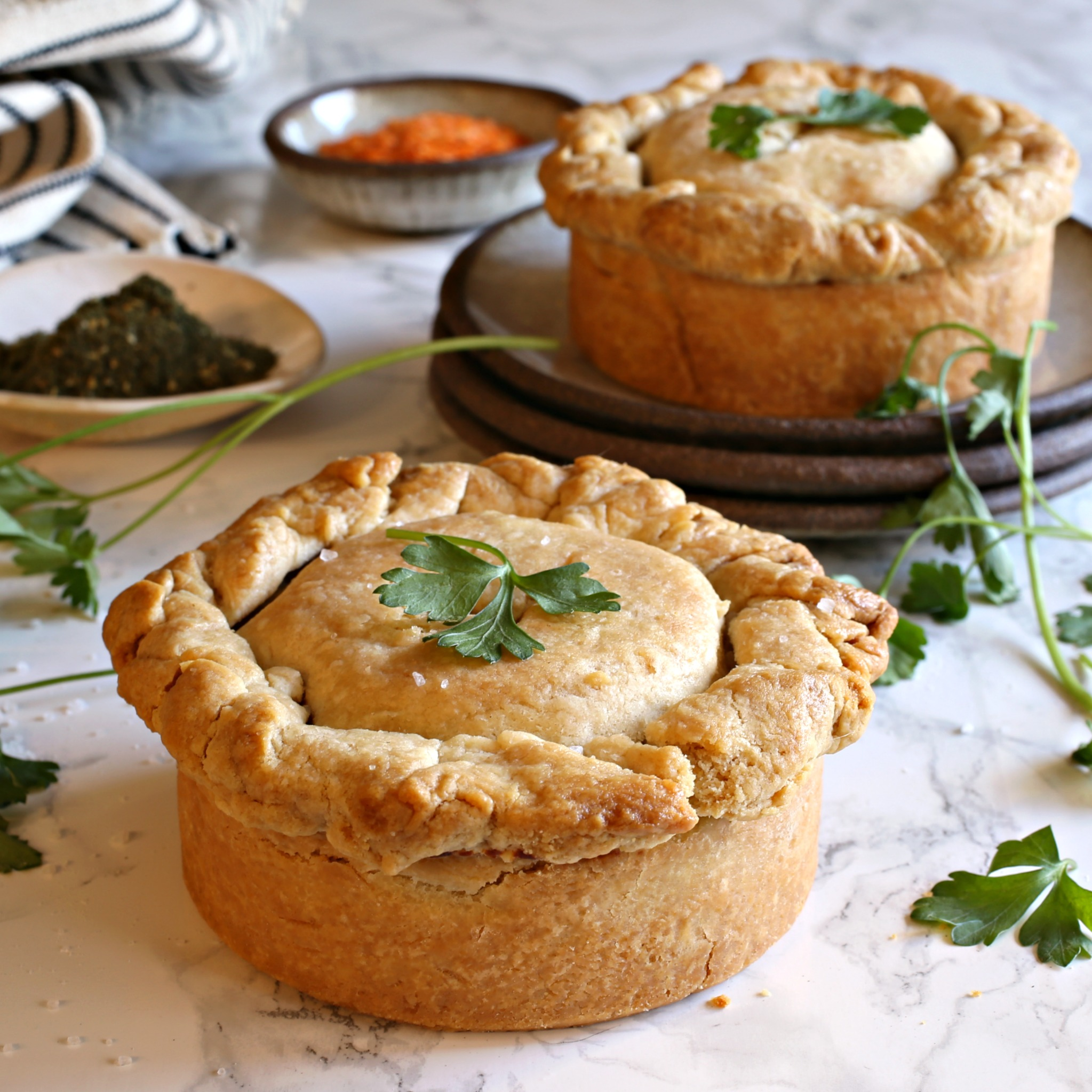 Recipe for individual pot pies filled with vegetables and red lentils in a cheesy sauce.