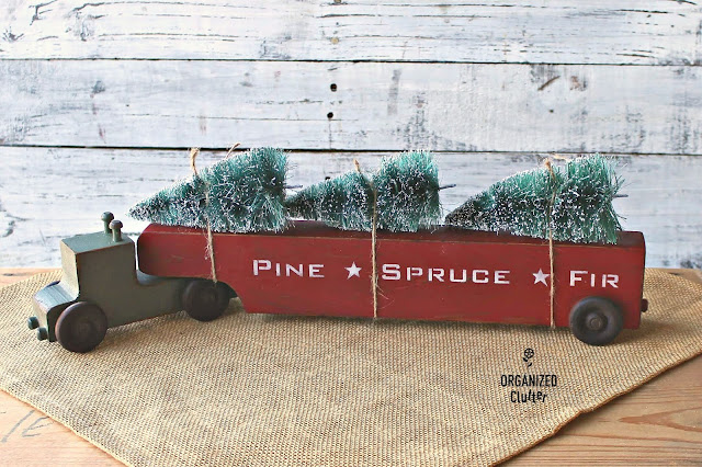 Photo of a toy wooden truck & trailer decorated for Christmas