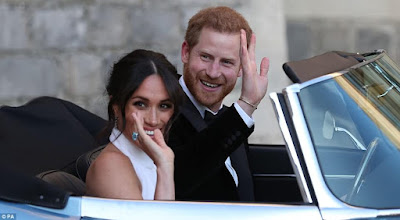 Meghan Markle is stunning in her second dress as she and her new husband head to their wedding reception (photos)
