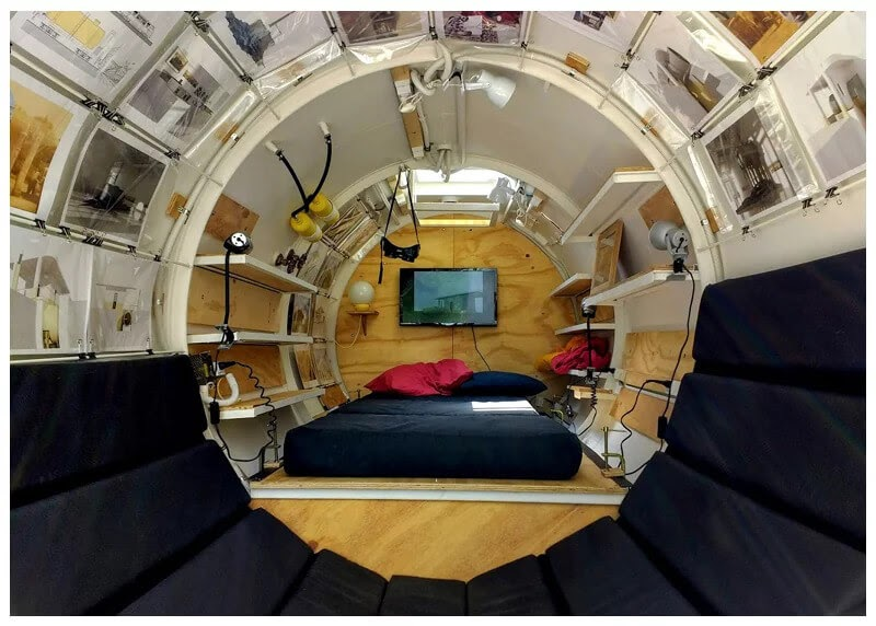 01-Bedroom-and-living-Area-Martin-Marro-Diesel-Tank-Minimalist-Tiny-Home-www-designstack-co
