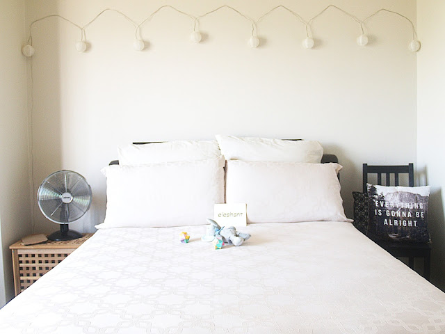 Eclectic bedroom with little lantern lights