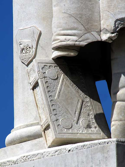 Marble book and Roman she-wolf, piazza Cavour, Livorno