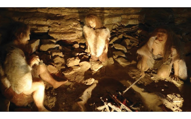 neanderthals family in a cave