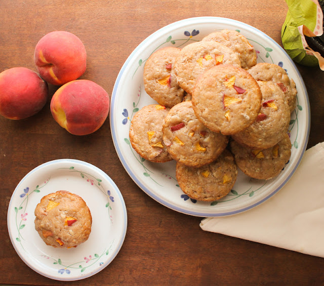 Food Lust People Love: Sweet Peach Cream Cheese Muffins celebrate the best of summer peaches with a wonderfully subtle tang. They are perfect for a summertime brunch, breakfast or snack.