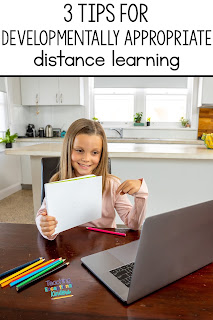girl showing paper to the computer for distance learning