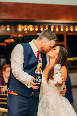 bride and groom with custom koozies