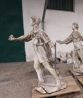Dismantled figures of an old sculpture 3