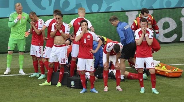 Danish midfielder Eriksen hospitalized after on-field collapse