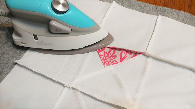 Pressing the seams of my Exploding Heart quilt