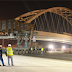 Moving a 122.5 m Arch bridge in 7 hours