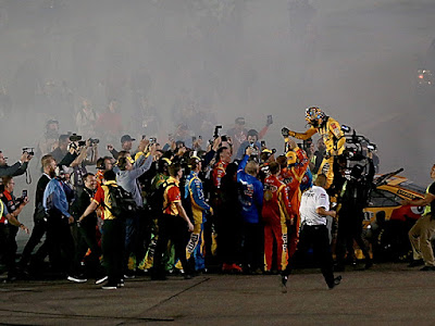 Kyle Busch, driver of the No. 18 for Joe Gibbs Racing, celebrates winning both the race and championship - #NASCAR