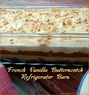 French Vanilla Butterscotch Refrigerator Bars are a no-bake dessert. A vanilla cookie crust is topped with both French Vanilla and creamy butterscotch layers. No baking required, refrigerate and serve. | Recipe developed by www.BakingInATornado.com | #recipe #dessert