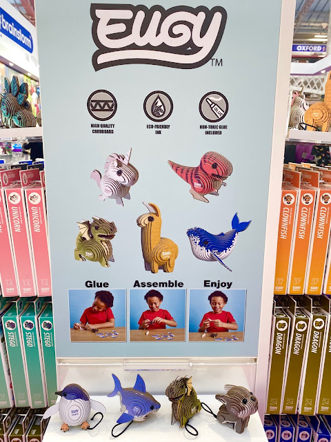 A display area showing assembled Eugy cardboard animals including a penguin, shark, dragon and dog