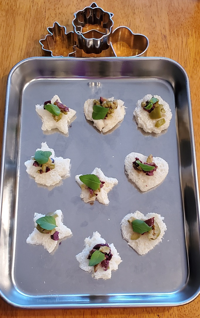this is cookie cutter bread appetizers with 3 types of olives on top