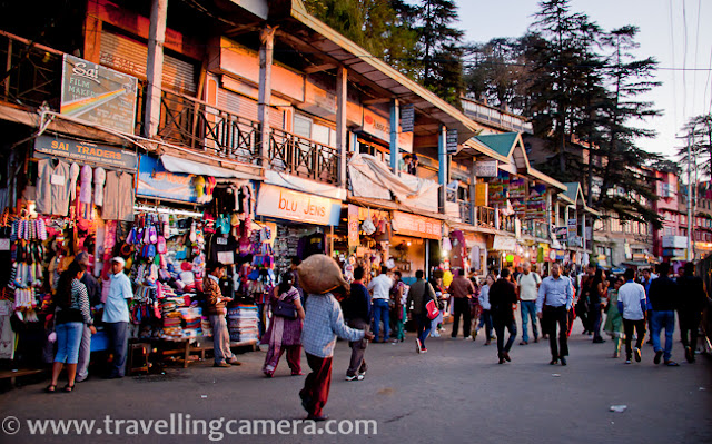 This PHOTO JOURNEY is about one of the wonderful walks around capital city of Himachal Pradesh, INDIA. Since Shimla is blessed with wonderful weather throughout the year, people love to walk from one place to other and now many tourists love to explore these walks and few of them avoid due to age issues. Above photograph shows Sanjauli from the road which connects Sanjauli Market with Mall Road through IGMC and Lakkar Mazar...The first thing which comes on the way to Mall Road from Sanjauli Market. Sanjauli College 'Rajkiya Mahavidyalaya, Sanjauli' ... It's one of the popular educational institution in Shimla !!!This is new building on Government College Sanjauli... Somehow all the buildings in Shimla are beautiful and each one sets new standards in terms of architecture ...This is huge complex of biggest Medical College of Himachal Pradesh. Indira Gandhi Medical College, Shimla.Main building on Indira Gandhi Medical College (IGMC), Shimla !!! This whole campus has one hospital and a Medical college. This is one of the most advanced hospital  in Himachal Pradesh, INDIA. Place is also known as snowdown.This is one of the popular walks around Mall Road. Few years back, cycles were also available on rent for this route form Sanjauli to Mall Road !!! This is approximately 3 kilometers walk through some of the beautiful spots on the way...It's impossible to reach Mall Road, without meeting monkeys on the way and we were lucky to have a silent meeting :) ... This family was happily sitting on roof-top !!!It was evening time and after crossing IGMC, we got to see the hues of sunset in Shimla. Have you see clear sun like this? It's easy to find full moon like this but brightness around the sun always hide the actual shape.After few miles of walk on relatively calm roads, we hit Lakkar Bazar. Lakkar Bazar is one of the main markets in Shimla and popular among tourists. There are lot of shops offering wooden materials for home and offices.Since none of us was interested in shopping, we moved towards Ridge with wonderful lighting around Christ Church... Sky was clear on that day and it was blue hour...After having some tea and snacks, we moved towards Mall Road. The building in above photograph is Gaiety Theatre building on Mall Road. This building is renovated last year only.For a change we also visited Lower Bazar, which is relatively cheap and a decent place to buy woolens. This market has various sections - cloth market, spice market, meat market etc...This walk ended in Lower Bazar of Shimla, but most of the folks from Sanjauli love to take this walk for mall road. The other way to reach Mall road is via bus, which is longer route of 8 kilometers. After that one needs ot climb up till Mall Road or take Lift.