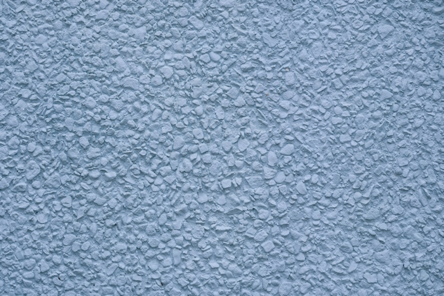 Smooth blue painted stone stucco wall texture